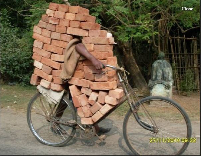 A man moves bricks by using his bike as a transportation device. Source: http://topyaps.com/unique-things-in-india
